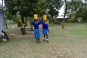 The Water Project: Tande Primary School -  Carrying Water