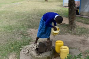 The Water Project: Tande Primary School -  Fetching Water At Home