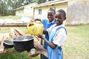 The Water Project: Tande Primary School -  Girls Deliver Water To The Kitchen