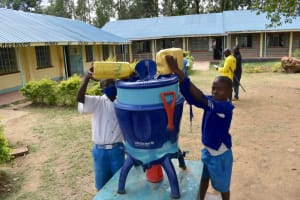 The Water Project: Tande Primary School -  Pupils Fill Lifestraw Filter With Water