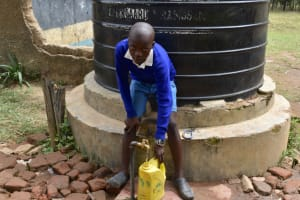 The Water Project: Tande Primary School -  Sammy Fetching Water