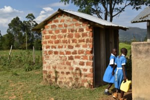 The Water Project: Tande Primary School -  Washing Latrines With Water