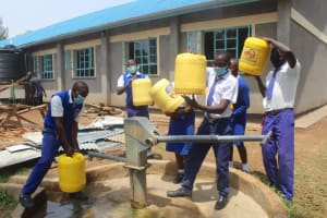 The Water Project: St. Stephens ACK Eshiakhulo Secondary School -  Hoisting Water Up