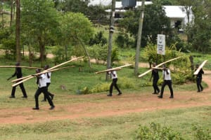 The Water Project: Friends Mixed Secondary School Lwombei -  Students Help Carry Timber For Construction