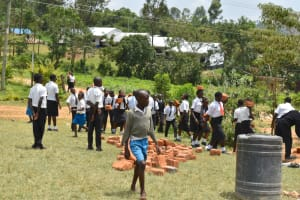 The Water Project: Friends Mixed Secondary School Lwombei -  Students Help Deliver Materials For Construction