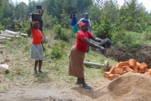 The Water Project: Elwichi Community, Mulunda Spring -  Delivering Materials By Hand