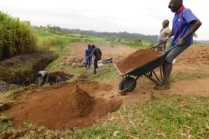 The Water Project: Mukoko Community, Zebedayo Mutsotsi Spring -  Ferrying Local Materials To Construction Site