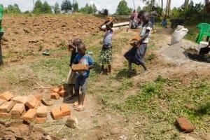 The Water Project: Mukoko Community, Zebedayo Mutsotsi Spring -  Children Ferrying Local Materials To Construction Site