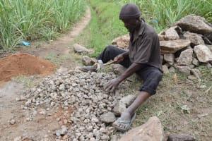 The Water Project: Mukhuyu Community, Gideon Kakai Chelagat Spring -  Community Member Making Gravel