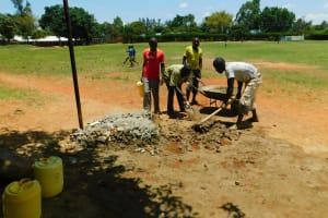The Water Project: Ibokolo Primary School -  Preparing Concrete And Cement