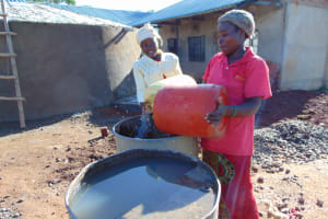 The Water Project: Gidimo Primary School -  Women Delivering Water For Construction
