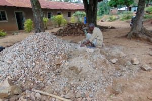 The Water Project: Kitambazi Primary School -  Breaking Down Rocks Into Gravel