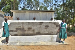 The Water Project: Kitambazi Primary School -  Girls In Front Of Their New Latrines