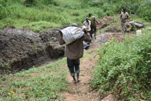 The Water Project: Emutetemo Community, Lubale Spring -  Community Members Help Deliver Materials
