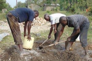 The Water Project: Elwichi Community, Mulunda Spring -  Mixing Mortar