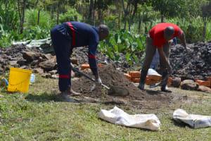 The Water Project: Isanjiro Community, Musambai Spring -  Mixing Cement