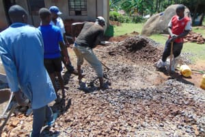 The Water Project: Gidimo Primary School -  Community Members Mixing Concrete