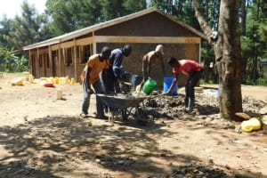 The Water Project: St. Martin's Primary School -  Community Members Help Mix Concrete