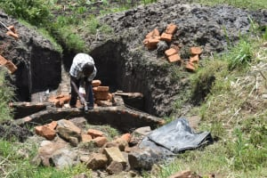 The Water Project: Mabanga Community, Ashuma Spring -  Setting The Pipe