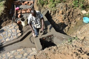 The Water Project: Emutetemo Community, Lubale Spring -  Plastering The Walls