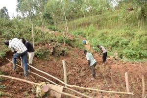 The Water Project: Mushikulu B Community, Olando Spring -  Setting Up The Protective Fence
