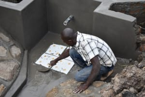 The Water Project: Mabanga Community, Ashuma Spring -  Placing The Tiles