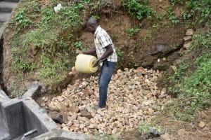 The Water Project: Emutetemo Community, Lubale Spring -  Layer Of Small Rocks