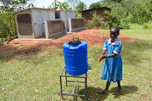 The Water Project: Gidimo Primary School -  Sharon Using A New Handwashing Station