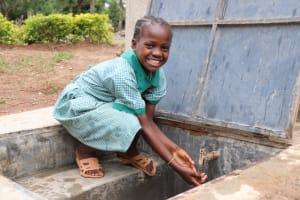 The Water Project: Friends Musiri Primary School -  Enjoying Water
