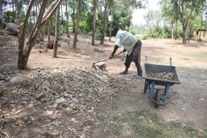 The Water Project: Mabanga Community, Ashuma Spring -  Community Member Preparing Construction Materials