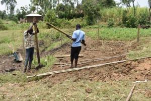 The Water Project: Mabanga Community, Ashuma Spring -  Setting Up Protective Fence