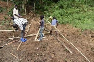 The Water Project: Emutetemo Community, Lubale Spring -  Setting Up Of Protective Fence