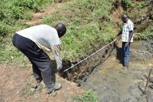 The Water Project: Emutetemo Community, Lubale Spring -  Confrming Of Measurements