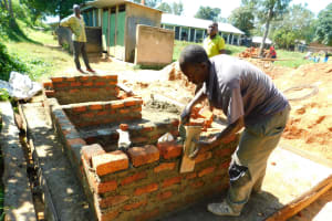The Water Project: Ibokolo Primary School -  Working On Latrine Walls