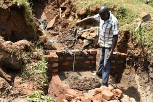 The Water Project: Mushikulu B Community, Olando Spring -  Setting The Pipes