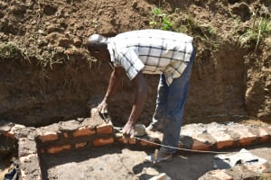 The Water Project: Emutetemo Community, Lubale Spring -  Reinforcing Walls With Wire