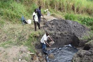 The Water Project: Mabanga Community, Ashuma Spring -  Laying The Foundation