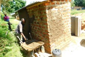 The Water Project: Ibokolo Primary School -  Cementing Latrine Walls