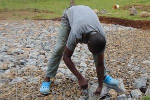 The Water Project: Friends Mixed Secondary School Lwombei -  Filling Excavated Area With Stones And Wire