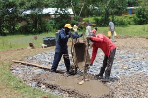 The Water Project: Friends Mixed Secondary School Lwombei -  Laying Concrete On Stones