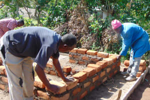 The Water Project: Friends Mixed Secondary School Lwombei -  Latrine Wall Construction