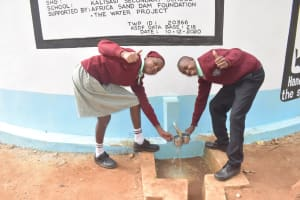 The Water Project: Kalisasi Secondary School -  Collecting Water From The Tank