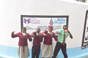 The Water Project: Kalisasi Secondary School -  Drinking Water From The Tank