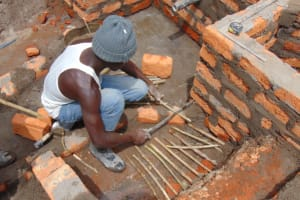 The Water Project: Elwichi Community, Mulunda Spring -  Escape Channel Construction