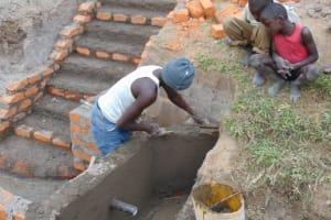 The Water Project: Elwichi Community, Mulunda Spring -  Plaster Works
