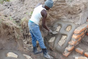 The Water Project: Elwichi Community, Mulunda Spring -  Stone Pitching