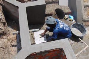 The Water Project: Elwichi Community, Mulunda Spring -  Tile Setting