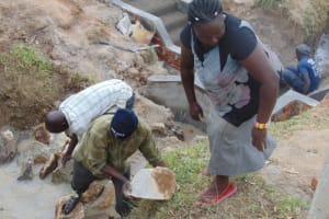 The Water Project: Elwichi Community, Mulunda Spring -  Backfilling With Rocks