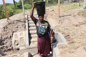 The Water Project: Elwichi Community, Mulunda Spring -  Carrying Water Home