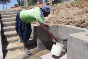 The Water Project: Elwichi Community, Mulunda Spring -  Collecting Water